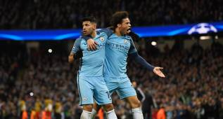 Sergio Aguero of Manchester City (L) celebrates with Leroy Sane
