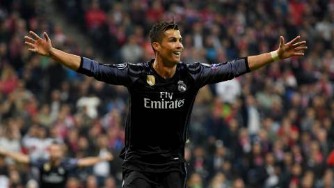 MUNICH, GERMANY - APRIL 12:  Cristiano Ronaldo #7 of Real Madrid celebrates after he scores his team's 2nd goal during the UEFA Champions League Quarter Final first leg match between FC Bayern Muenchen and Real Madrid CF at Allianz Arena on April 12, 2017 in Munich, Germany.  (Photo by Matthias Hangst/Bongarts/Getty Images)