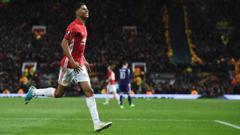 Manchester United's English striker Marcus Rashford celebrates scoring their second goal during the UEFA Europa League quarter-final second leg football match between Manchester United and Anderlecht at Old Trafford in Manchester, north west England, on April 20, 2017. / AFP PHOTO / Oli SCARFF