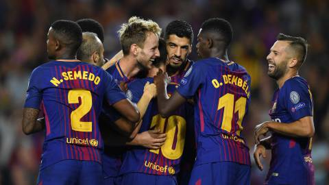 Ivan Rakitic of Barcelona celebrates scoring his sides second goal with his Barcelona team mates during the UEFA Champions League Group D match between FC Barcelona and Juventus at Camp Nou