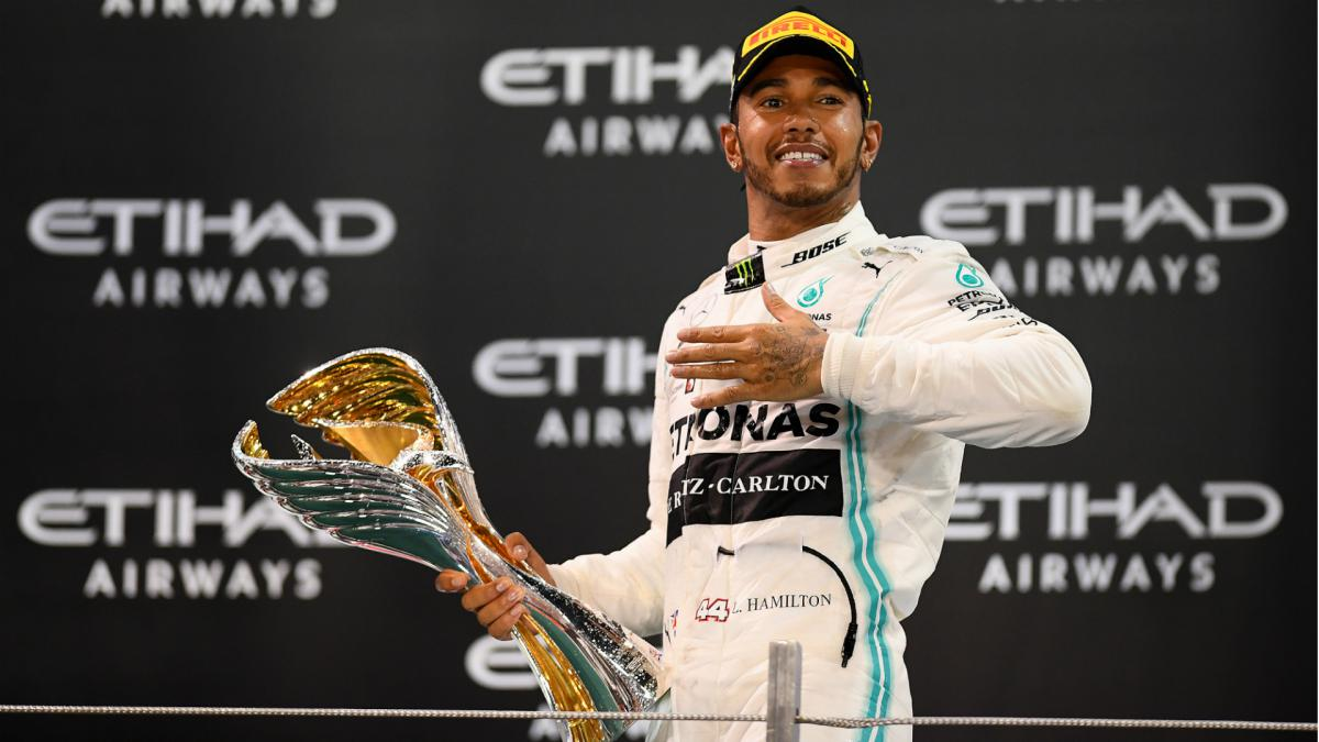 Lewis Hamilton Collects F1 World Championship Trophy As Com